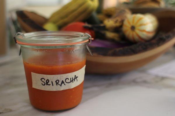 homemade sriracha in a jar