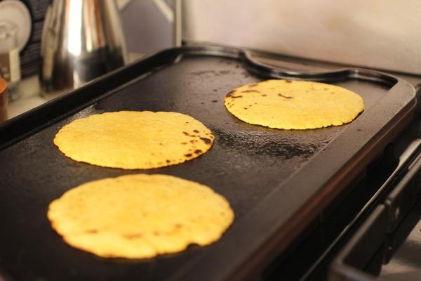 griddling corn tortillas